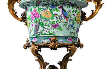 A LARGE FRENCH ORMOLU-MOUNTED CHINESE FAMILLE ROSE PORCELAIN JARDINIERE-ON-STAND