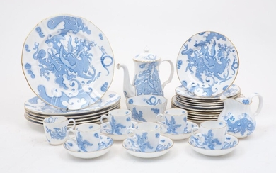 A Royal Worcester blue dragon pattern part coffee and dessert service, with date marks for 1885, comprising: a coffee pot with cover, 19cm high, a creamer, 10cm high, a sugar bowl, 11cm diameter, six coffee cans with saucers, the cans 5.5cm...