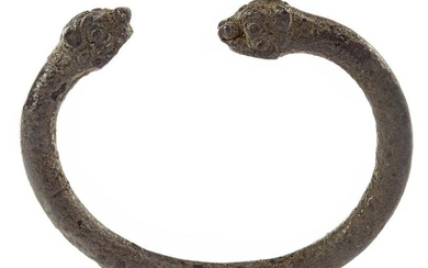 A SILVER ACHOMANID BANGLE WITH HEADS OF MYTHOLOGICAL
