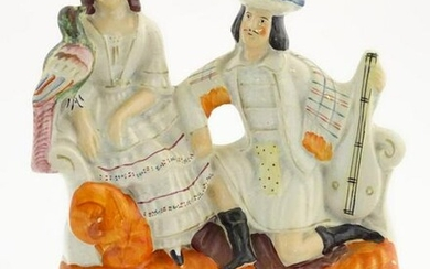 A Staffordshire flatback figural group of a man with a