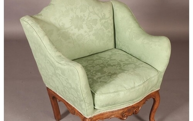 A VICTORIAN WALNUT OCCASIONAL CHAIR having an arched back an...
