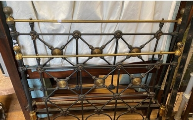 A cast iron and brass double bedframe, 136 cm wide