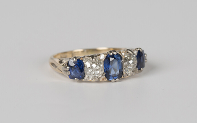 A gold, sapphire and diamond five stone ring, mounted with three cushion cut sapphires alternating w