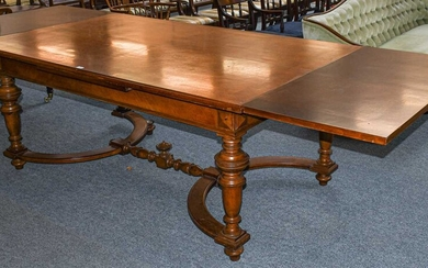 A late 19th century French walnut extending dining table,...