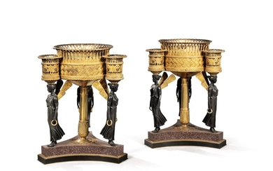 A pair of Empire style gilt and patinated bronze and porphyry jardinières after Pierre-Philippe Thomire