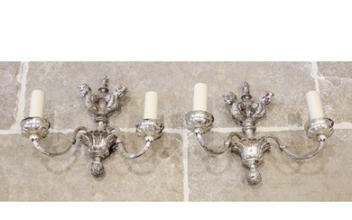 A pair of chromed metal twin branch wall light sconces, earl...