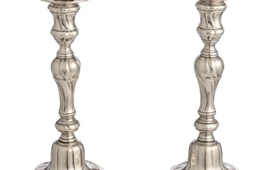 A pair of silver Rococo period candlesticks, Mons hallmarked, dated (17)60, H 23,4 cm - weight c. 770 g.