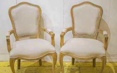 FAUTEUILS, a pair, Louis XV style oak, in taupe upholstery, ...