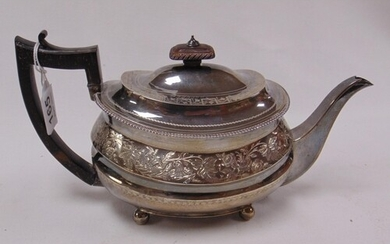 George silver teapot of oval form, with floral chased decora...