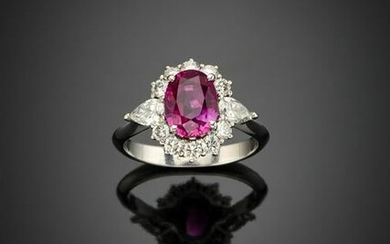 Oval ct. 2.75 ruby with pear and round diamond white