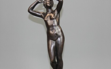 A 19th century classical bronze figure of a female nude on a red marble base, H. 29cm.