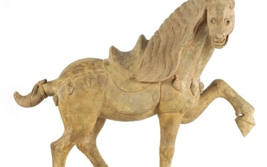 A CHINESE EARTHENWARE MODEL OF A TANG HORSE with polychrome ...