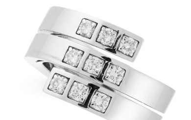 A DIAMOND RING, CARTIER in 18ct white gold, the band