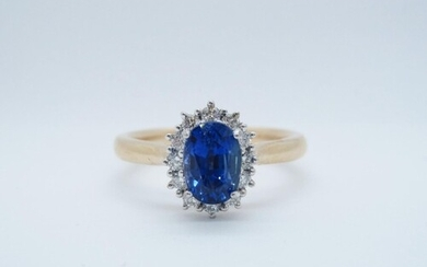 A Sapphire and Diamond Cluster Ring, claw-set oval-cut sapph...