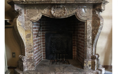A breccia marble fireplace