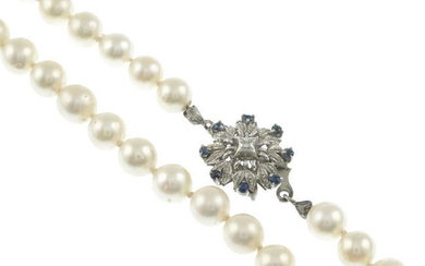 A cultured pearl single-strand necklace, with sapphire and diamond cluster clasp.