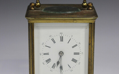 A late 19th/early 20th century brass corniche cased carriage clock with eight day movement striking