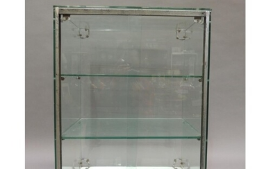 A mid 20th century glass and chrome cake display case, with ...