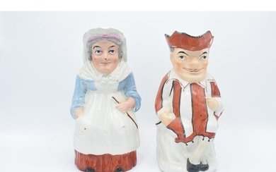 A pair of 19th century large Staffordshire Toby jugs to cons...