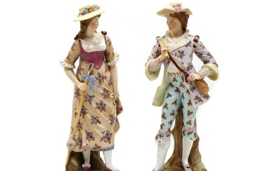 A pair of continental porcelain figurines