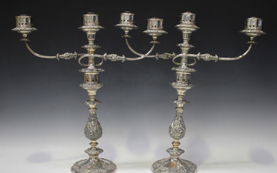 A pair of mid-19th century Sheffield plate three-light twin scroll branch candelabra, each with pier