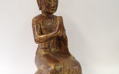 An Eastern carved wood and painted figure in prayer, 53 cm h...