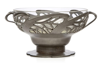 Orivit (German), an Art Nouveau pewter twin-handled bowl with original glass liner, Stamped 'Orivit 2325', The pierced pewter with twin sinuous handles raised on a short ribbed stem and shaped foot and having the original external patina, original...