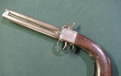 Percussion cap over and under pistol with side mounted steel...