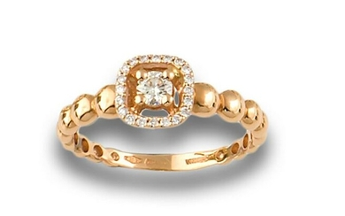 RING WITH CENTER DIAMONDS AND ORLA OF DIAMONDS