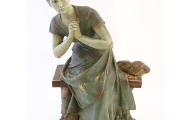A 20thC French terracotta sculpture of a seated woman on a b...