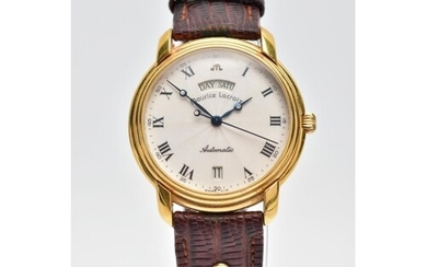 A GENTS AUTOMATIC MAURICE LACROIX WRISTWATCH, round champagn...
