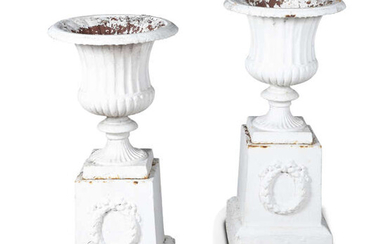 A PAIR OF WHITE PAINTED CAST IRON GARDEN...