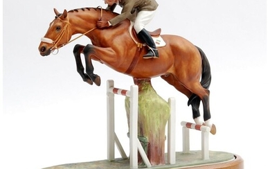 A boxed limited edition Royal Worcester Equestrian Statuette...
