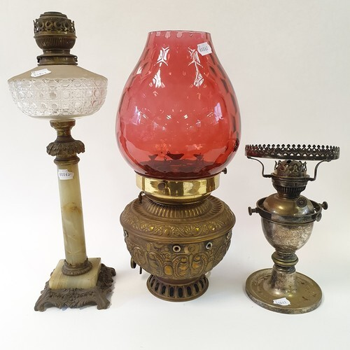 A brass oil lamp with cranberry glass shade, four other oil ...