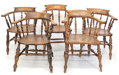 A collection of five late 19th-century beech and elm club chairs