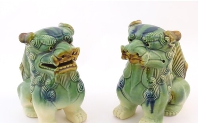 A matched pair of Chinese models of foo dogs / guardian lion...