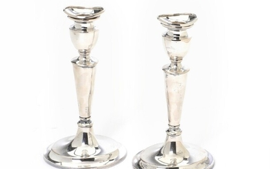 A pair of Danish silver candlesticks. Svend Toxværd. Filled. H. 19 cm. (2) – Bruun...
