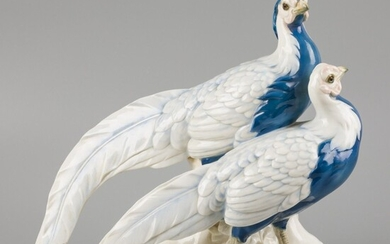 A porcelain sculpture group of a pair of gold pheasants, marked Passau, Germany, circa 1930....