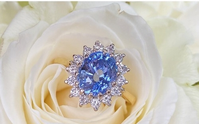 A sapphire and diamond cluster ring, the central oval mixed ...