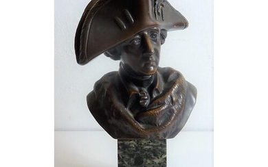 A well patinated figure of a standing bronze Napoleon wearin...