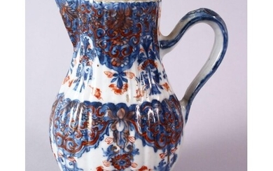 AN 18TH CENTURY CHINESE IMARI RIBBED PORCELAIN JUG, with und...