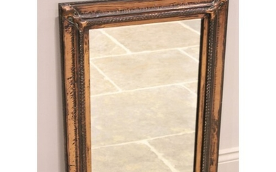 An early 20th century Arts and Crafts copper wall mirror, th...