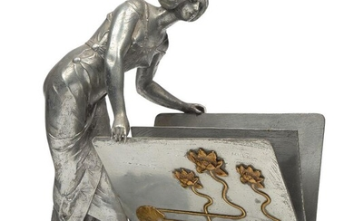 Elsie Ward Hering (American 1872-1923), a Spelter and bronze figural letter holder, c.1900, signed Hering, Modelled and cast as an art nouveau maiden leaning over the letter holder which is embellished on one side with lilies on sinuous stems and a...