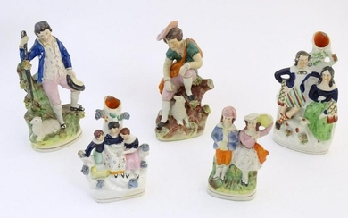 Five assorted Staffordshire pottery figures comprising