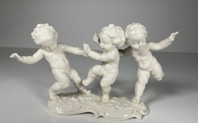 KARL TUTTER. Porcelain figure from the Hutschenreuther art department Germany, playing putti.