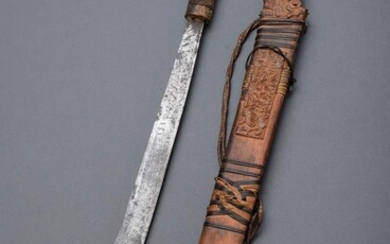 """Mandau"" sword of the Dayak (headhunters) in richly carved wooden..."