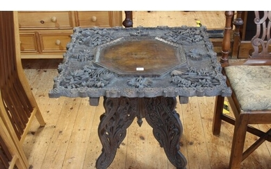 Oriental relief carved foliate and leaf occasional table wit...