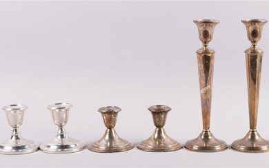 PAIR OF MUECK-CAREY CO. SILVER WEIGHTED CANDLESTICKS, AND A PAIR OF STIEFF AND GORHAM SILVER LOW STICKS