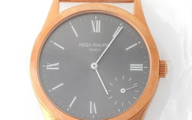 Patek Philippe. Limited Edition and Sophisticated Calatrava Wristwatch in Pink Gold, Reference 5026, With Grey Dial Made for the New Millennium and Extract from Archives