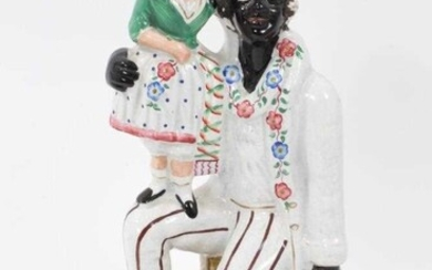 Staffordshire pottery group of Uncle Tom and Little Eva
